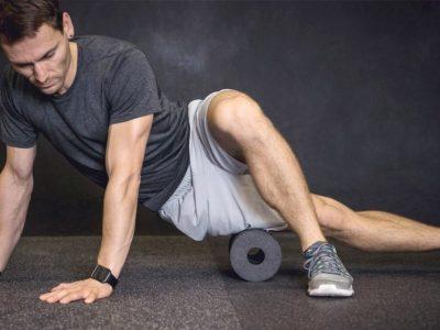 Fitness-Man-Foam-Rolling-Quadricep-Muscle